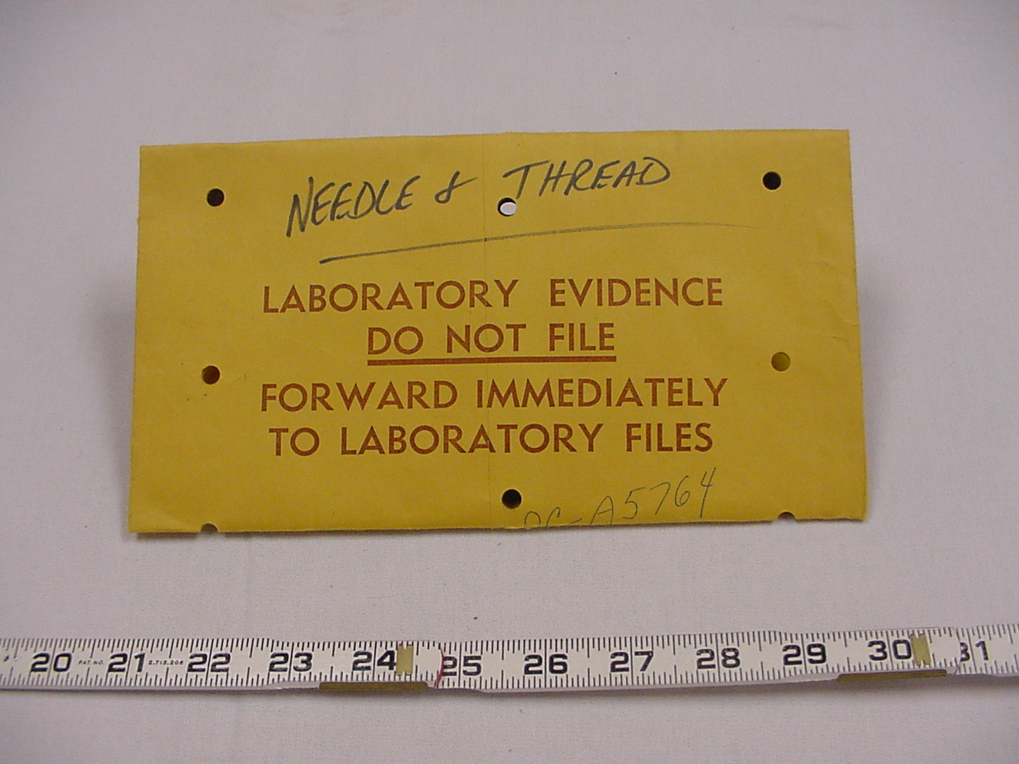 needle and thread laboratory envelope 1.jpg