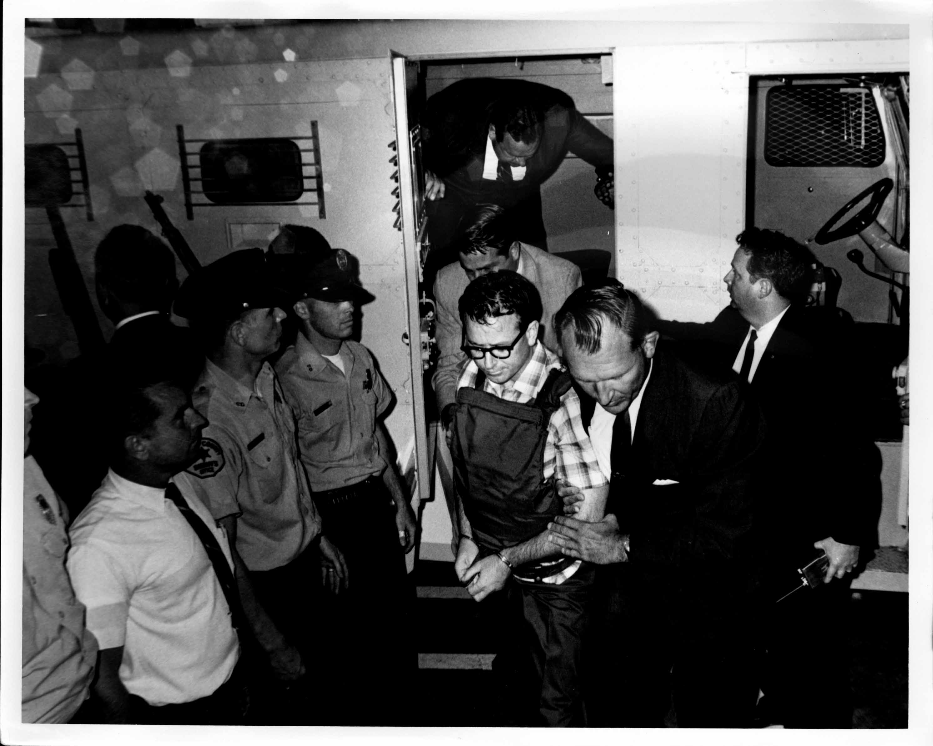 01James Earl Ray being brought into jail 01.jpg