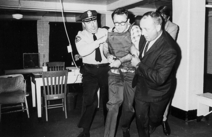 02James Earl Ray being brought into jail 02.jpg