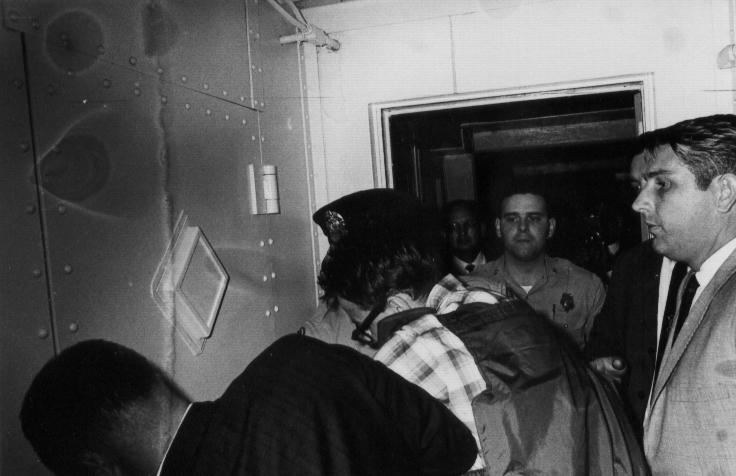 09James Earl Ray being brought into jail 09.jpg