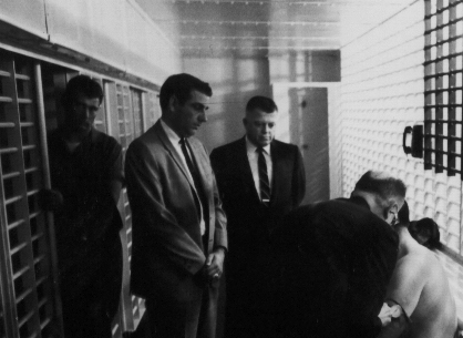16James Earl Ray being searched 06.jpg