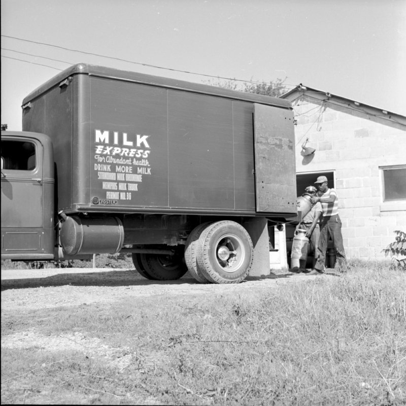052_the cans to load the truck. (1954).jpg